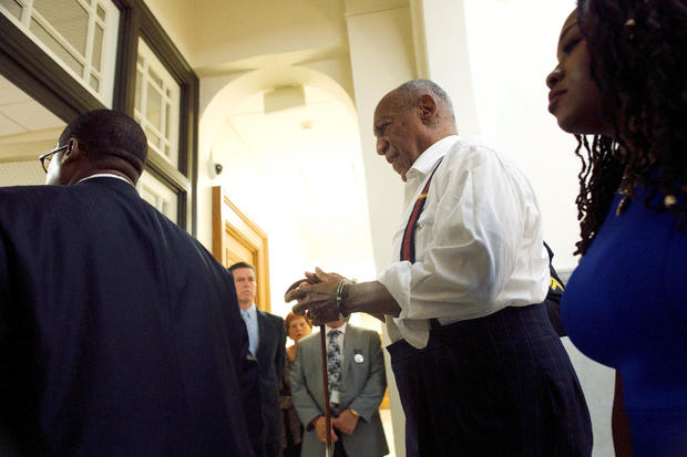 Bill Cosby departs the Montgomery County Courthouse in handcuffs after being sentenced in his sexual assault trial on September 25, 2018 in Norristown