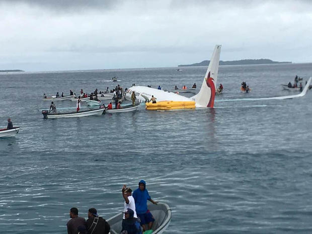 People are evacuated from an Air Niugini plane crashed in the waters in Weno, Chuuk, Micronesia