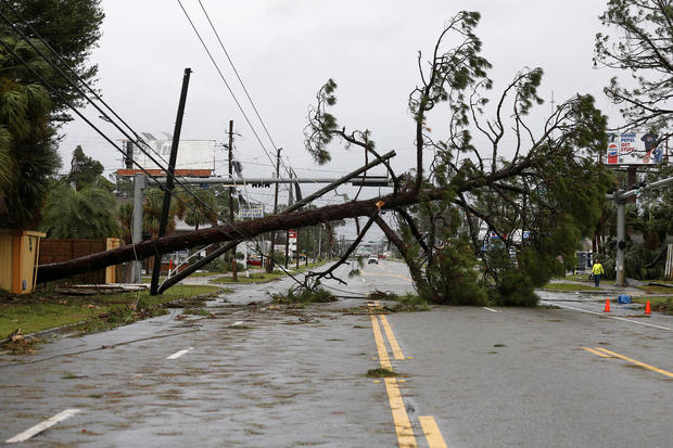 A downed tree and power lines block a road during Hurricane Michael in Panama City Beach