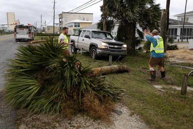 Emergency crews work to clear a street of debris during Hurricane Michael in Panama City Beach