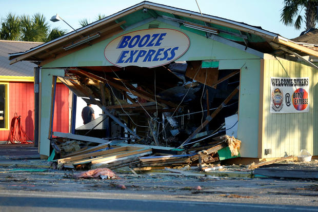 A man inspects a damaged building caused by Hurricane Michael in Panama City Beach