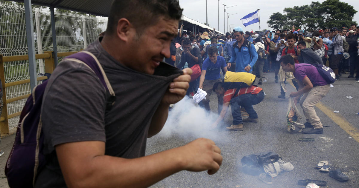 Migrant caravan to U.S. faced Mexican riot police and pepper spray