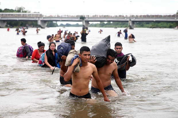 Central American migrants, part of a caravan trying to reach the U.S., cross the Suchiate River to avoid the border checkpoint in Ciudad Hidalgo