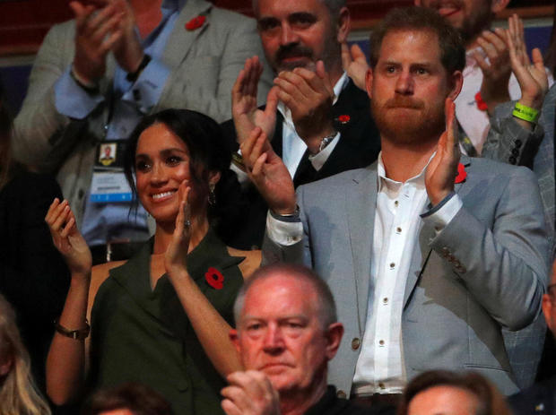 Britain's Prince Harry and Meghan, Duchess of Sussex, at the Invictus Games Sydney closing ceremony