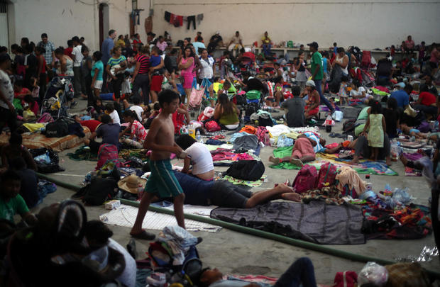 Migrants, part of a caravan of thousands traveling from Central America en route to the United States, rest in a makeshift camp in Santiago Niltepec