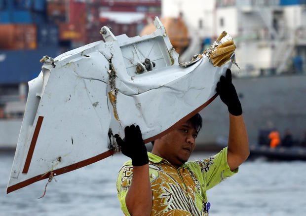 A worker loads up recovered debris believed to be from Lion Air flight JT610 onto a truck at Tanjung Priok port in Jakarta
