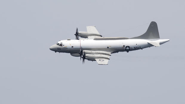 An EP-3E Aries performs a flyby.                        U.S. Navy  Mass Communication Specialist 3rd Class Bobby J. Siens