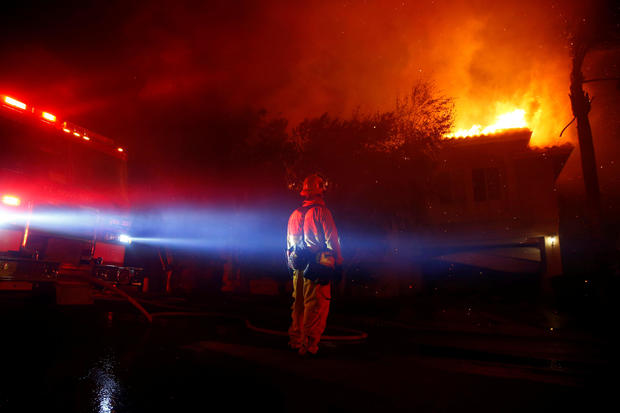Firefighters battle flames overnight during a wildfire that burned dozens of homes in Thousand Oaks