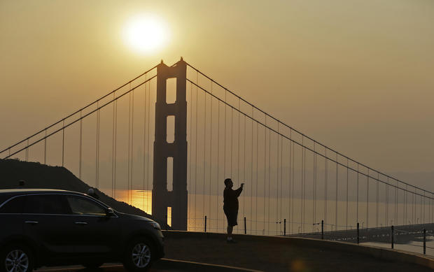 Mahmoud El Tahawy of Egypt looks out at smoke from wildfires obscuring the San Francisco skyline behind the Golden Gate Bridge Nov. 9, 2018, near Sausalito, California.