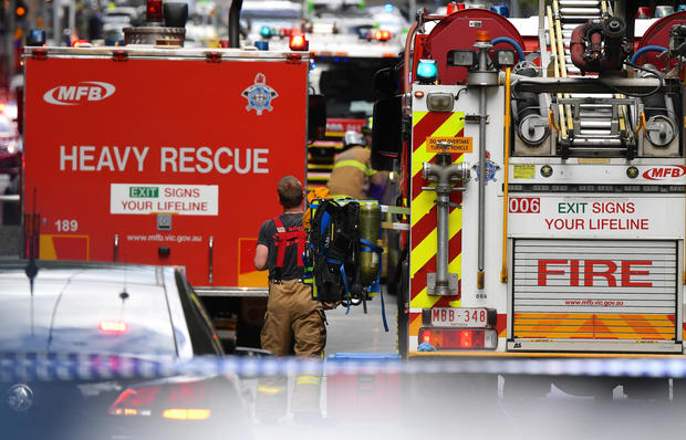 Emergency rescue personnel can be seen near the Bourke Street mall in central Melbourne