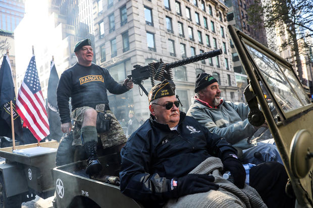 People attend the Veterans Day parade in New York City