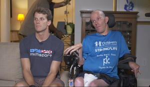 Brotherly love: Duo conquers Ironman triathlons together despite brother's cerebral palsy