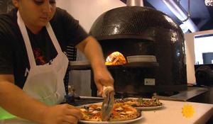 Deaf staff serves up pizza at top California restaurant Mozzeria