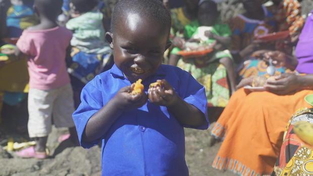 child-eating-orange-fleshed-sweet-potatoes-2.jpg