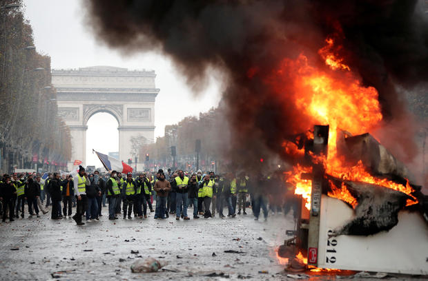 "A truck burns during a ""Yellow vest"" protest against higher fuel prices during clashes on the Champs-Elysees in Paris"
