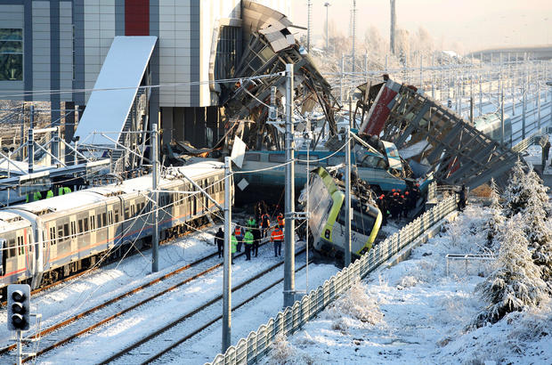 Rescue workers search at the wreckage after a high speed train crash in Ankara