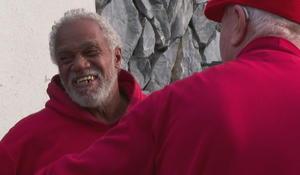 Homeless man helps Secret Santa give out $100 bills to strangers