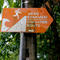 A sign directing to a tsunami evacuation route is seen after a tsunami hit an area near Carita in Pandeglang