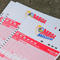 Mega Millions lottery entry tickets are seen in New York
