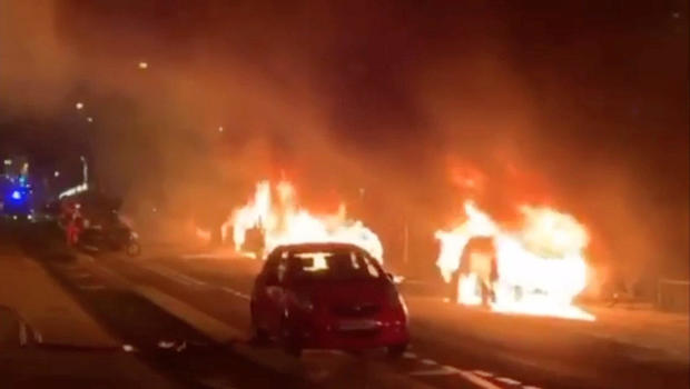 """Cars are set on fire during a protest by the """"yellow vests"""" movement in Paris"""