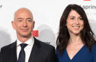 Amazon CEO Jeff Bezos and his wife MacKenzie Bezos pose as they arrive at the headquarters of publisher Axel-Springer on April 24, 2018, in Berlin.