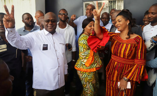 FILE PHOTO: Felix Tshisekedi, leader of the Congolese main opposition party, the Union for Democracy and Social Progress (UDPS), and a presidential candidate, shows a victory sign after casting his ballot at a polling station in Kinshasa