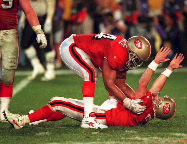 San Francisco 49ers quarterback Steve Young (on gr