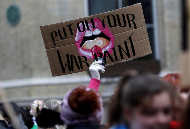 Protesters take part in the Women's March calling for equality, justice and an end to austerity in London
