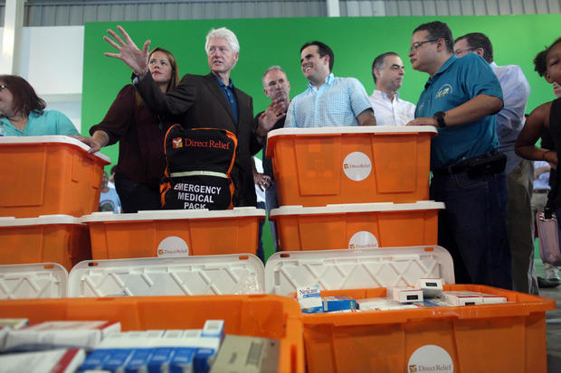 Former U.S. President Clinton and Puerto Rico Governor Rosello visit a school turned shelter for people who have lost their homes during Hurricane Maria in September, in Canovanas