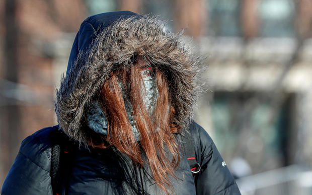 A student is dressed for subzero temperatures at the University of Minnesota in Minneapolis