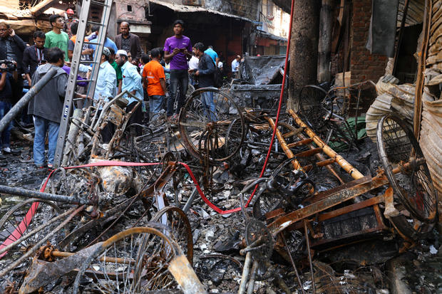 Debris are seen outside the burnt warehouse at Chawkbazar in Dhaka