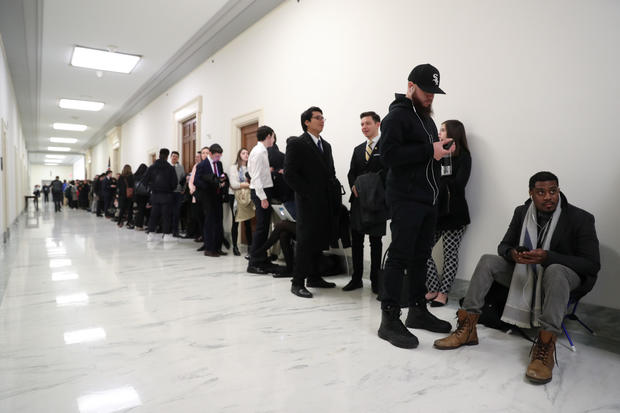 People line up inside the Rayburn House Office Building before Cohen testimony at House Oversight and Reform Committee hearing on Capitol Hill in Washington