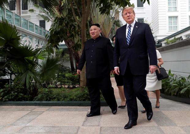 North Korean leader Kim Jong Un and U.S. President Donald Trump walk in the garden of the Metropole hotel during the second North Korea-U.S. summit in Hanoi, Vietnam