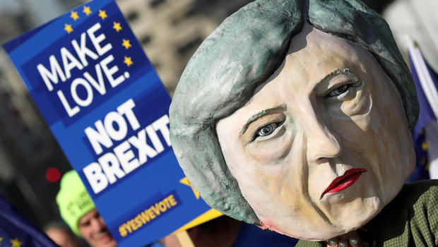 A protester dressed as Britain's Prime Minister Theresa May is seen amongst anti-Brexit demonstrators ahead of a EU Summit in Brussels