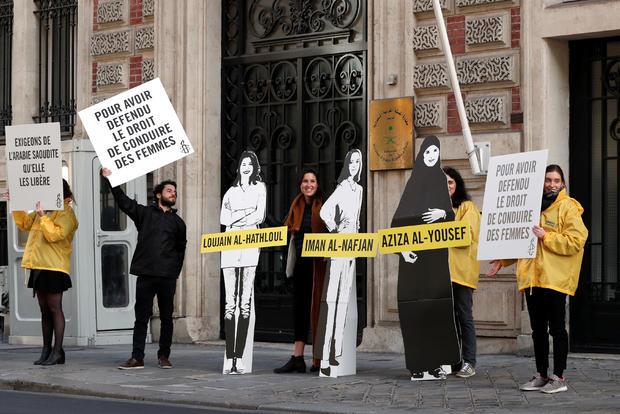 Demonstrators from Amnesty International protest outside the Saudi Arabian Embassy on International Women's day in Paris