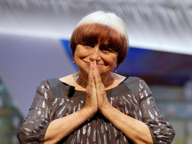 FILE PHOTO: Filmmaker Agnes Varda reacts being awarded with an honorary Palme d'Or during the closing ceremony of the 68th Cannes Film Festival in Cannes