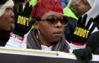 "Lesley McSpadden, mother of Michael Brown, helps lead the ""Justice For All"" rally and march in the nation's capital against police brutality and the killing of unarmed black men by police Dec. 13, 2014, in Washington."