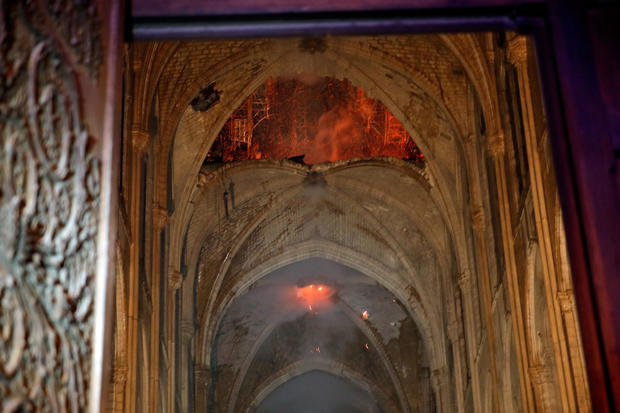 Flames are seen as the interior continues to burn inside the Notre Dame Cathedral in Paris