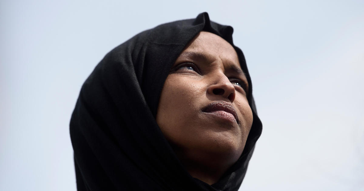 photo image Omar supporters hold rally outside Trump event in Minnesota