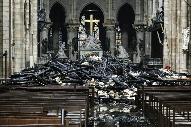 Charred debris surrounds the altar of Paris' Notre Dame Cathedral in the aftermath of a massive fire April 16, 2019.