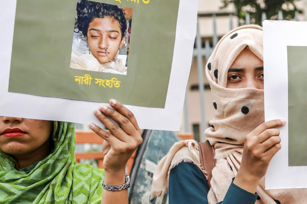 Bangladeshi women hold placards and photographs of schoolgirl Nusrat Jahan Rafi at a protest in Dhaka April 12, 2019, following her murder by being set on fire after she had reported a sexual assault.