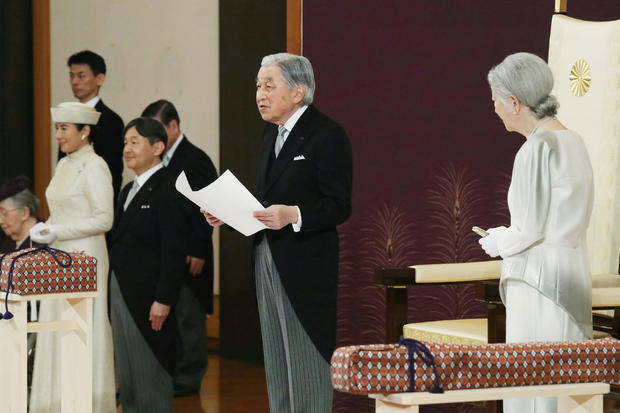 Japan's Emperor Akihito, flanked by Empress Michiko, Crown Prince Naruhito and Crown Princess Masako, delivers a speech during a ritual called Taiirei-Seiden-no-gi, a ceremony for the Emperor's abdication, at the Imperial Palace in Tokyo