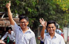 Reuters reporters Wa Lone and Kyaw Soe Oo gesture as they walk to Insein prison gate after being freed, after receiving a presidential pardon in Yangon