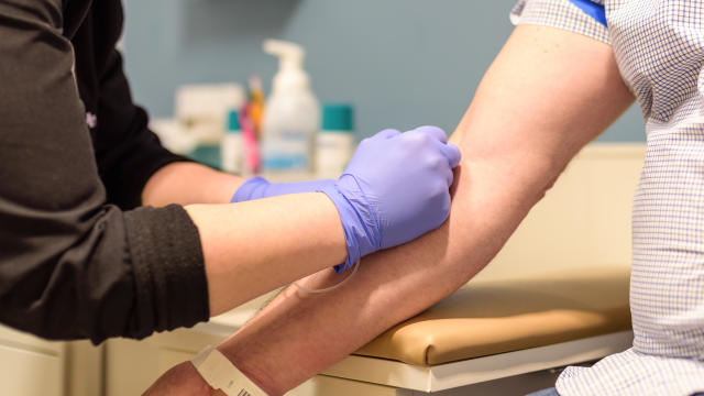 Man getting blood drawn at routine health screening