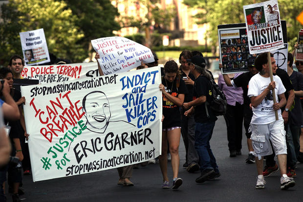 Protestors Rally Against Police Violence 1 Year After Eric Garner's Death