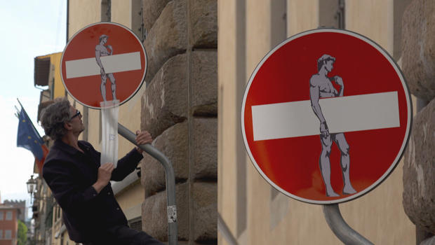 clet-at-work-on-street-sign-in-florence-620.jpg