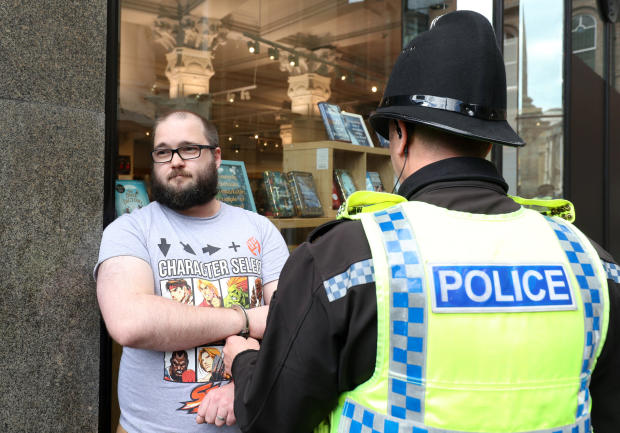 A man is detained by police after throwing a milkshake on Brexit Party leader Nigel Farage before a Brexit Party campaign event in Newcastle, Britain, May 20, 2019.
