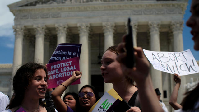Women demonstrate at a protest against anti-abortion legislation at the U.S. Supreme Court in Washington