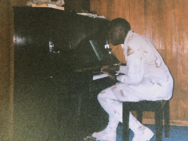 michael-trotter-jr-at-the-piano-in-iraq.jpg