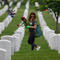 Volunteers Place Flowers On Gravesites At Arlington National Cemetery Ahead Of Memorial Day